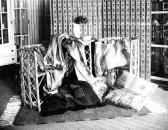 Dobová fotografie interiéru obchodu na Ferdinandově (Národní) třídě